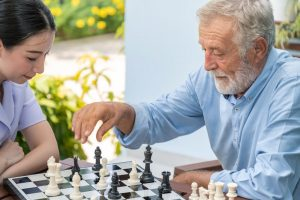 Friendly Visiting - a client and a visitor play chess together